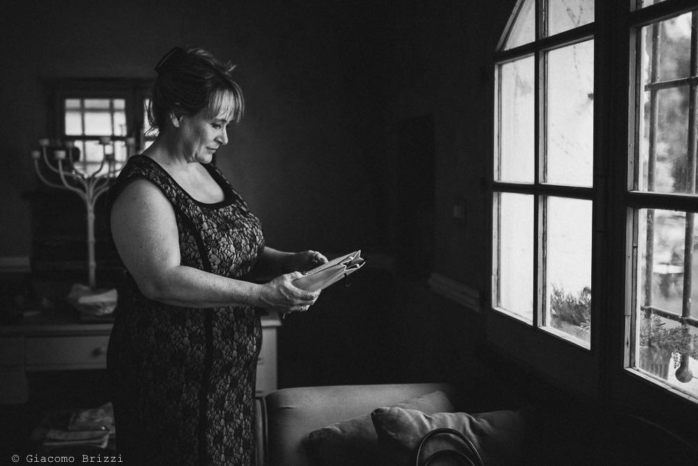 Primo piano su signora, fotografo matrimonio ricevimento la ginestra, finale ligure